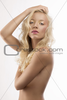pretty blonde girl with naked torso and hand on the head