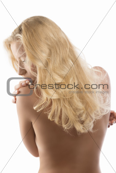 naked blonde girl turned back looks down