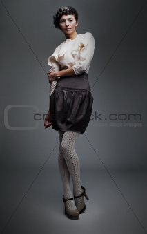 Lovely fashion model girl in retro black skirt, white shirt