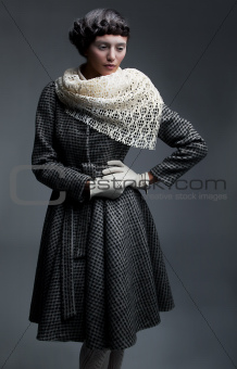 Fashion model in retro garments - white shawl, gloves and  coat