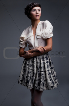 Lovely aristocratic fashion model in retro clothes posing