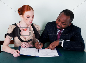Education - black american man and redhead young woman