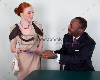 Businesspeople in office interior smiling