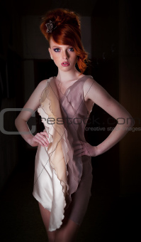 Red hair freckled super model posing in fashion dress