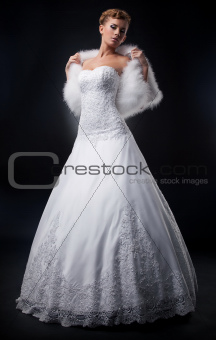 Spectacular pretty bride blonde in nuptial white dress