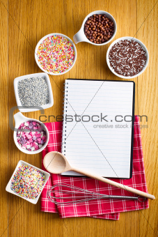 Recipe book with a variety of candy sprinkles.