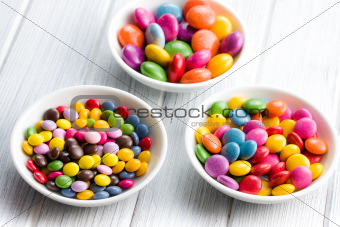 Three different sizes of colorful candies