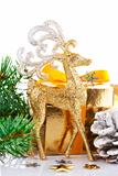 christmas gold deer with branch firtree and gift