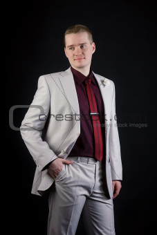attractive young man in suit and tie