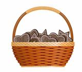 Basket with ginger cakes into white background