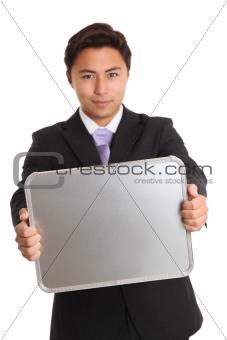 Businessman holding a chrome sign