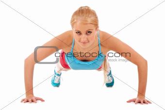 Beautiful girl doing push-ups