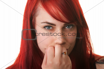 Skeptical Woman with Fingers on Mouth