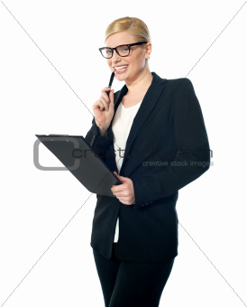 Smiling mischievous female business executive
