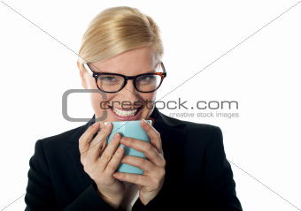 Corporate woman enjoying coffee