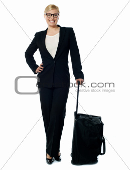 Corporate person carrying trolley bag