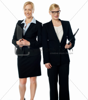 Two businesswoman over white background