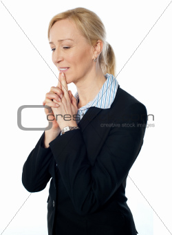 Senior corporate woman posing with fingers on her lips