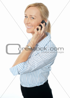 Smiling businesswoman talking on phone