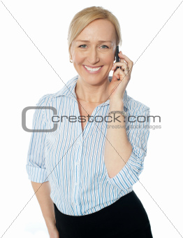 Corporate female communicating on phone