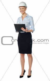 Full length view of a successful senior female architect