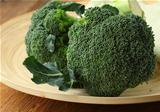 Natural organic broccoli on a wooden table