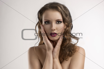 sexy girl with purple make-up and hands on the face