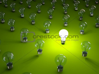 Rows of light bulbs on green background