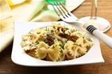 farfalle pasta with beef sauce  on  plate with  fork