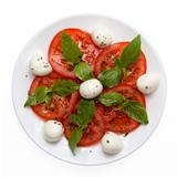 caprese salad on plate directly above
