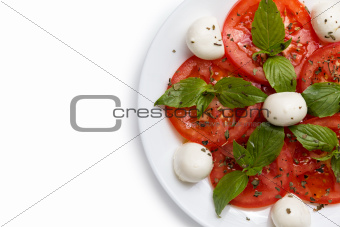 part of the plate with salad Caprese