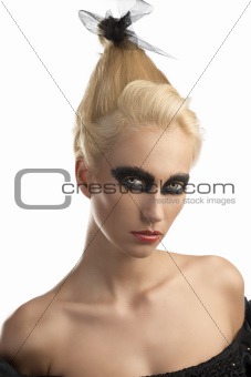 blonde girl with dark make-up turned of three quarters