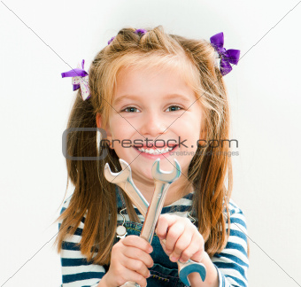 smiling girl with spanners