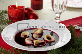 Red borscht (Czerwony barszcz) with mushroom dumplings
