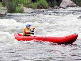 Young Man in Raft on White Water River