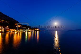 Small Dalmatian Village and Adriatic Sea Bay Illuminated by Moon