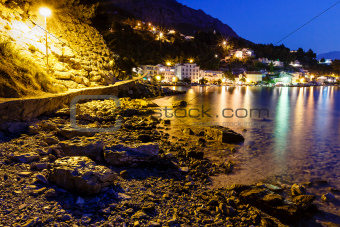 Illuminated Rocky Beach and Transparent Mediterranean Sea in the