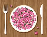Raspberries on plate with fork and knife on wooden background for your design