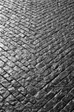 Grey cobbled street in a V shape