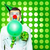 Crazy Party Clown Inflating Green Party Balloon