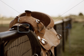 Saddle on a fence