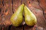 Two pears wooden on an background