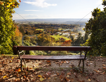 Bench in a park with views of the countryside.