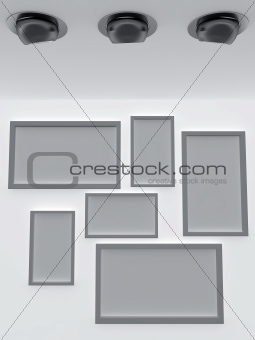 empty frames on the wall and ceiling lamp