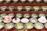 small bowls with water and rice around a temple