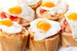Baguette Slice with Ham and Fried Quail Egg