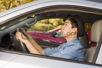 Very Stressed Mixed Race Woman Driving in Car and Traffic.