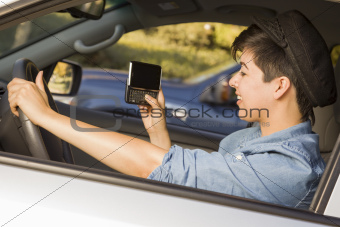 Mixed Race Woman with Smart Phone Texting and Driving.