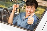 Happy Smiling Mixed Race Woman in Car with Thumbs Up Holding Set of Keys.