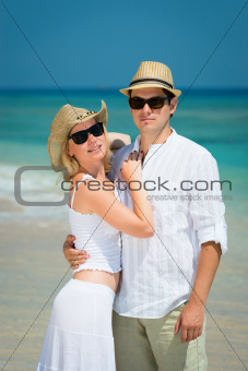  Young loving couple on a tropical beach
